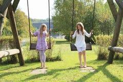 Дети - девушки на качании Стоковые Фото