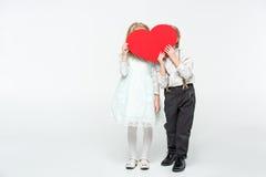 Дети держа красное сердце Стоковые Фотографии RF