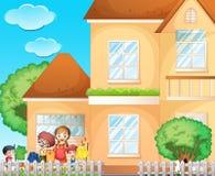 Дети делая прачечную дома Стоковая Фотография