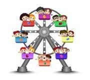 Дети играя в колесе Ferris Стоковое фото RF