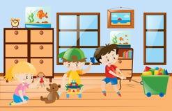 Дети играя игрушки внутри комнаты Стоковые Изображения