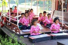 Дети играя музыкальный Таиланд Стоковое Изображение RF