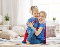 Дети играя superheros Стоковые Изображения RF