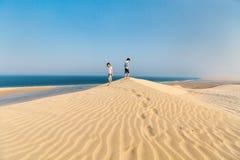 Дети имея потеху на пустыне Стоковое фото RF