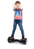 Дети используя hoverboard, само-балансировать 2-катили доску Редакционное содержание Стоковая Фотография RF