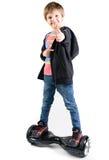 Дети используя hoverboard, само-балансировать 2-катили доску Редакционное содержание Стоковое Изображение