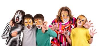 Дети и бабушка со сторон-краской стоковые изображения rf