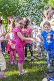 Дети и пузыри мыла Стоковое Изображение RF
