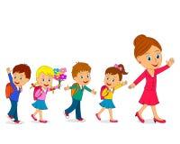Дети и учитель идут к школе Стоковое фото RF