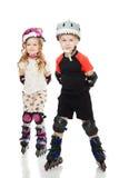 Дети катаются на коньках стоковое фото