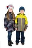 Дети моды в куртках зимы Стоковые Фотографии RF