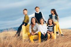 Дети моды в поле осени Стоковые Изображения RF