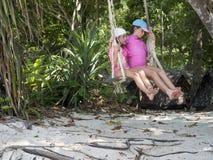 Дети на качании Стоковая Фотография RF