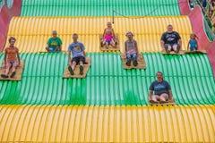 Дети на скольжении масленицы на положении справедливом Стоковое фото RF