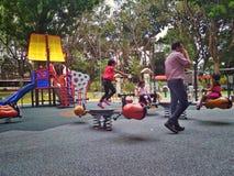 Дети на спортивной площадке Стоковое Изображение RF