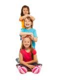 Дети одно за другими стоковые фото