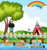 Дети плавая на реку в парке Стоковое Изображение