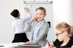 Дети работая в офисе Стоковое Изображение
