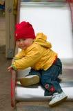 дети ребенка приходят вниз с скольжения s Стоковые Изображения RF