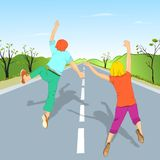 Дети скача на дорогу Стоковое Фото