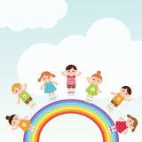 Дети скача на радугу. Стоковое Фото