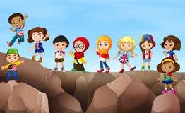 Дети стоя на скале иллюстрация вектора