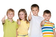 Дети с их большими пальцами руки вверх Стоковые Фотографии RF