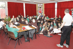 Дети учителя класса школы Стоковое фото RF