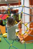 Детские игры на спортивной площадке стоковая фотография