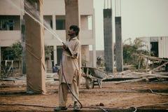 Детский труд на строительной площадке стоковые фотографии rf