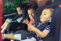 3 дет в месте ловителя кабины лифта Стоковое Изображение