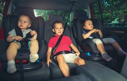 3 дет в месте ловителя кабины лифта Стоковые Фото