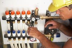 деятельность водопроводчика pipework Стоковая Фотография