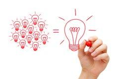 Деятельность команды на концепции электрических лампочек идеи стоковое фото rf