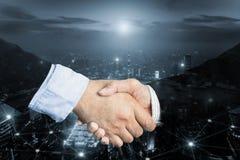 Дело или концепция дела согласования, двойная экспозиция рукопожатия, c Стоковые Изображения RF