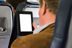 Дело места самолета человека вскользь читая пустую белую таблетку E-R стоковое изображение rf