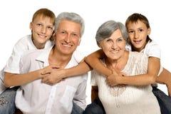 Деды и их 2 внука Стоковое Фото