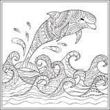 Дельфин в волнах Стоковые Фото