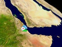 Джибути с флагом на земле Стоковые Фото