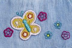 Джинсовая ткань с вышивкой стоковые фото