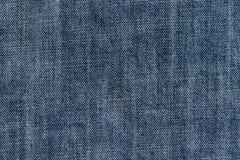 Джинсовая ткань ткани предпосылки Стоковые Изображения