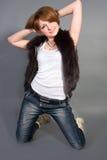 джинсыы девушки Стоковое Фото