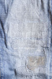 джинсыы текстурируют сорвано стоковая фотография