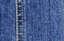 джинсыы ткани сини близкие вверх Стоковые Фотографии RF