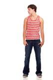 джинсыы укомплектовывают личным составом красной детенышей striped рубашкой белых Стоковое Изображение RF