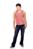 джинсыы укомплектовывают личным составом красной детенышей striped рубашкой белых Стоковые Фото