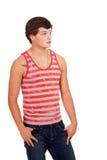 джинсыы укомплектовывают личным составом красной детенышей striped рубашкой белых Стоковые Фотографии RF