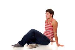 джинсыы укомплектовывают личным составом красной детенышей striped рубашкой белых Стоковая Фотография