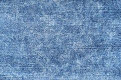 Джинсы в кисловочной сини мытья Предпосылка джинсовой ткани, текстура, конец вверх Fa Стоковое Изображение RF