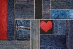 Джинсы джинсовой ткани с кожаной предпосылкой, демикотоном джинсовой ткани заплатки с кожаной картиной Стоковые Изображения RF